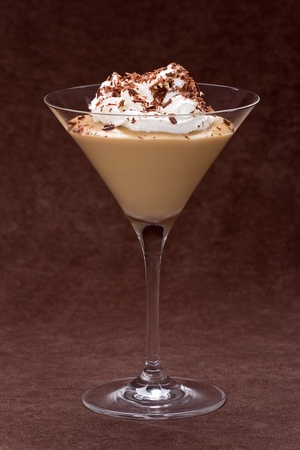 glass topped: Butterscotch pudding in a glass topped with whipped cream and chocolate shavings. Stock Photo
