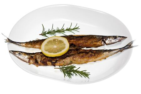 Two grilled mackerel pike with lemon on a white plate.