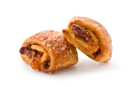 Closeup of two rugelach against a white background.