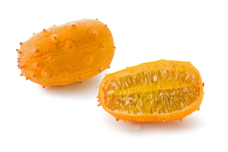hedged: Whole and sliced horned melon against a white background. Stock Photo