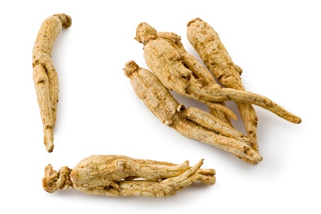 Composite of several pieces of whole dried white ginseng. Stock Photo