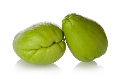 chayote: Two chayote squash, also known as christophine, pear-squash, vegetable pear and choko against a white background.