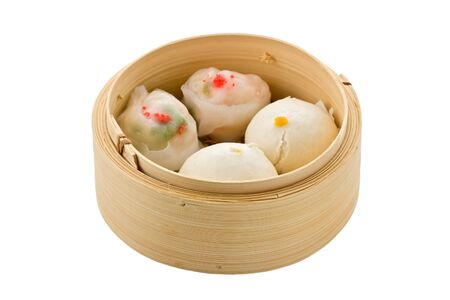 Assorted dim sum in bamboo steamer against a white background.