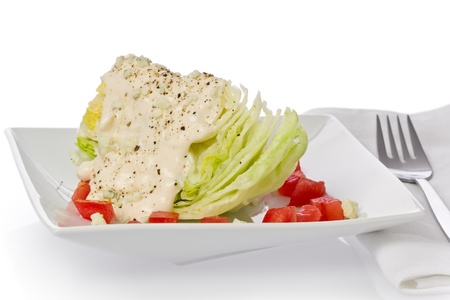 Iceberg lettuce wedge salad with blue-cheese dressing and cracked black pepper. 스톡 콘텐츠