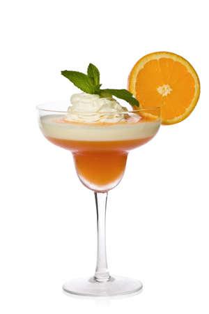 Apricot-orange and lemon parfait with orange sauce, whipped cream, mint, and a slice of orange.