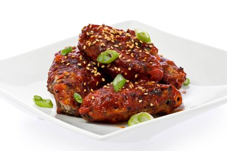 korean food: Korean-style fried chicken wings with spicy sauce.