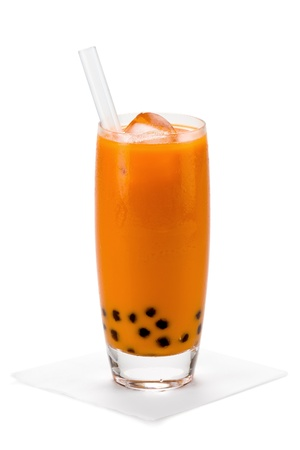 A glass of sweet thai iced tea with tapioca pearls, and straw on white background. Stock Photo