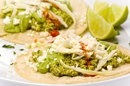 crumbly: Two vegetarian green tofu chorizo tacos with a guacamole sauce and crumbly cheese.