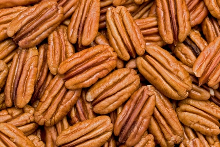 Background texture of shelled pecans.