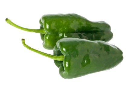 Two whole green poblano peppers against a white background. Imagens