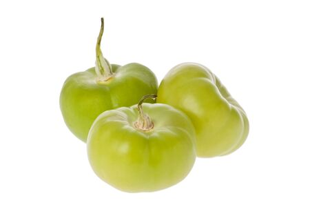 husk tomato: Three tomatillos with their husks removed against a white background.