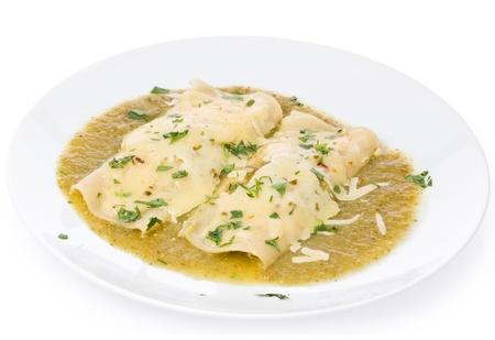 2 つすぐベジタリアン エンチラーダ tomatillos ・唐辛子で作ったグリーン ソース 写真素材