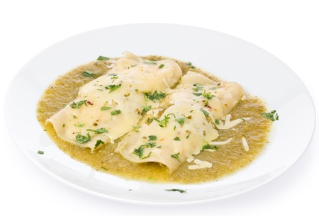 Two vegetarian enchiladas in a green sauce made with tomatillos and chilies. Stock Photo