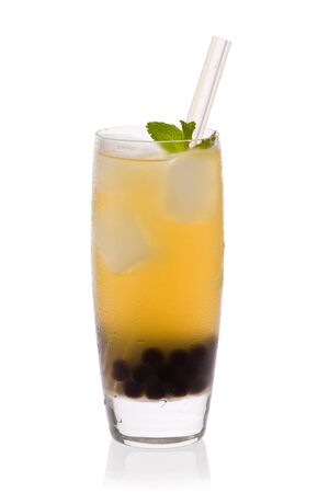 A glass of Lychee tea with tapioca pearls, and a straw against a white background.