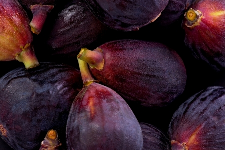 Background texture of several black mission figs.