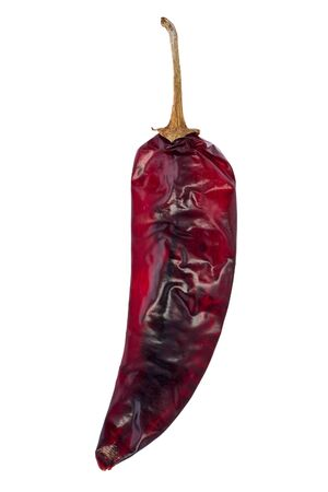 Single dried guajillo chili against a white background.