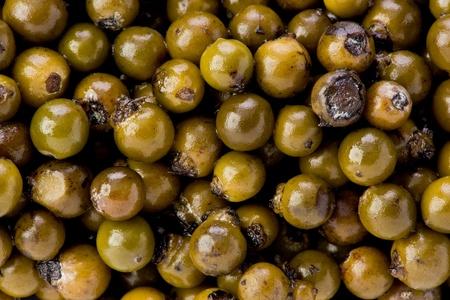 peppercorns: Background texture of green peppercorns. Stock Photo