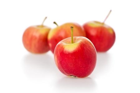 crimson: Several crimson gold crab apples against a white background. Stock Photo