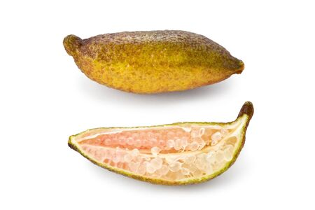 Composite of two finger limes. One whole and one sliced in half against a white background. Stock Photo