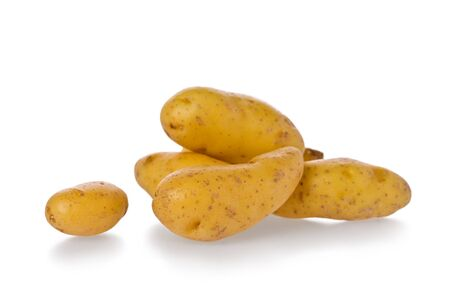 fingerling: Several whole fingerling potatoes against a white background. Stock Photo
