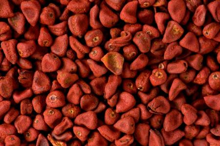 Antecedentes textura de semillas rojas achiote utilizados en la cocina mexicana (achiote pegar) y para los alimentos colorantes. Foto de archivo - 17276109