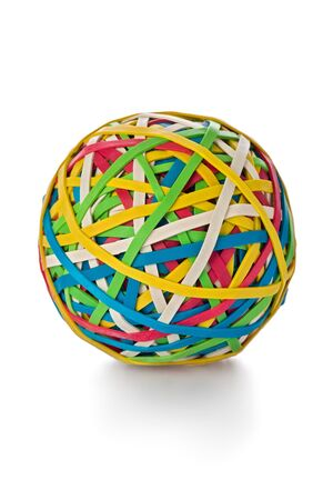 elastic: Ball made from colored rubber bands against a white background.
