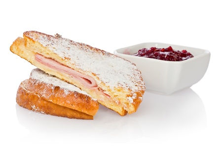 monte cristo: Monte Cristo sandwich with raspberry jam against a white background.