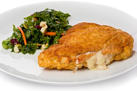 cordon: Chicken cordon bleu with a small green salad with carrots and blue cheese on a white plate  Stock Photo