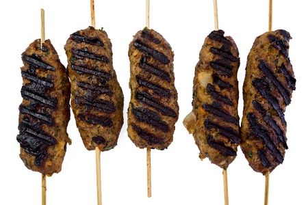 Several grilled lamb kofte kebabs against a white background Фото со стока - 20688246