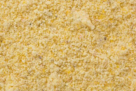 corn meal: Background texture of yellow corn meal