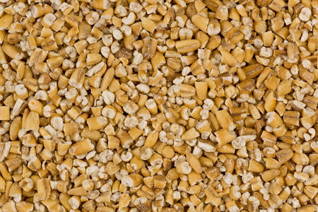 Background texture of steel-cut oats, or irish oats.