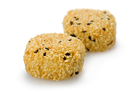 Sesame Mochi, or rice cake against a white background