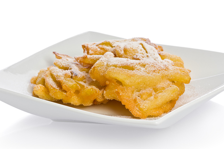 Sugar apple: Homemade apple fritters on a white appetizer plate. Stock Photo