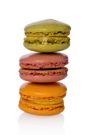 Three colored macaroons stacked on top of each other  photo