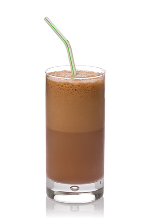 Chocolate egg cream in a glass with a drinking straw against a white background.