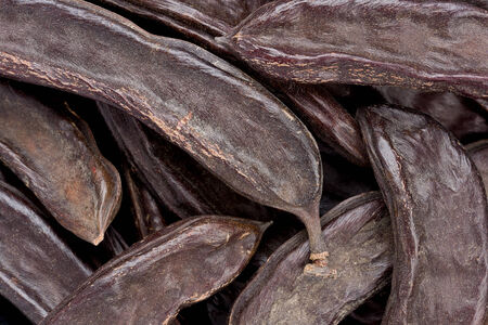 carob: Background texture of several whole carob pods, also known as St. Johns-bread.
