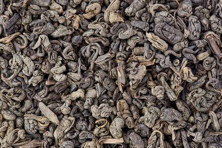 gunpowder tea: Background texture of dried, green, gunpowder tea.