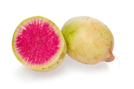 One whole, and one sliced, watermelon radish on a white background.