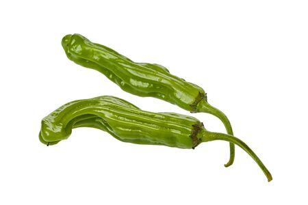 Two whole, fresh, Shishito Pepprs against a white background.