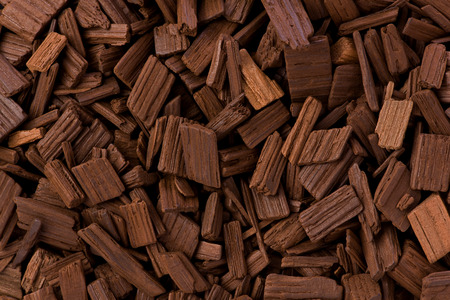flavours: background texture of french oak barrel chips used to flavor wine.