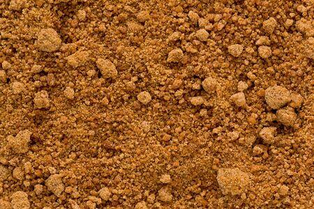 coconut sugar: Background texture of organic coconut sugar, also known as coco sap sugar.