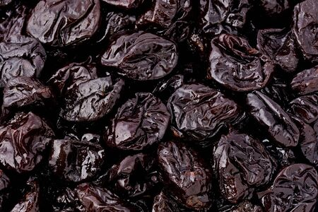 dried: Background texture of several prunes.