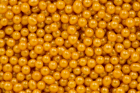 Background texture of gold sprinkles.