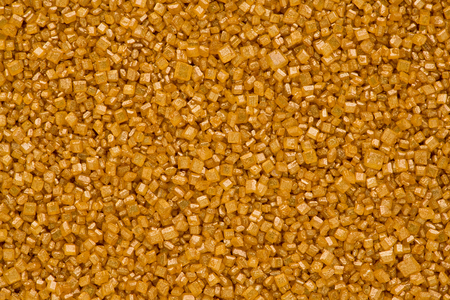 Background texture of gold sugar crystals.
