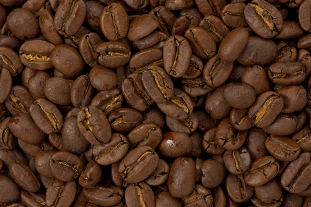 Background texture of whole medium roasted coffee beans. Stok Fotoğraf