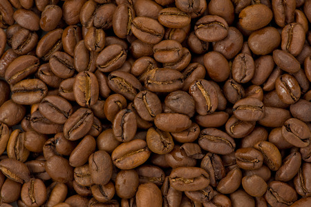 Background texture of whole light roasted coffee beans. Stok Fotoğraf