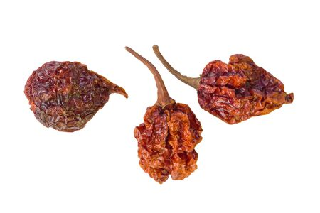 Three dried Scorpion peppers against a white background. Stock Photo