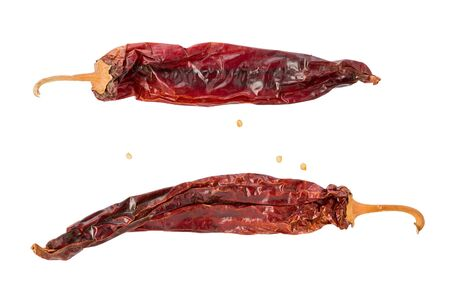 Two whole, dried, New Mexico chile, or chile de Nuevo Mexico, on a white background. Stok Fotoğraf