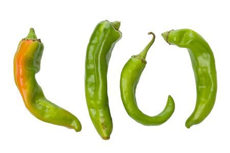 Four whole, fresh, green Hatch chile peppers against a white background. Stok Fotoğraf