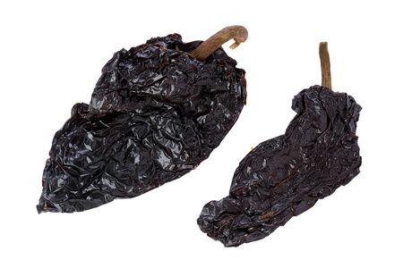 Two, whole, dried, Poblano chile peppers against a white background.